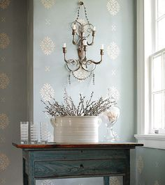 thibaut wallpaper. I love the combination of the wallpaper and the sconce