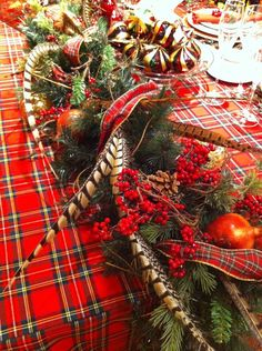 .tartan runner, pheasant feathers great for a Christmas table decor