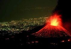Perched above the lighted city of Catania, Italy, Mount Etna hurls a fountain of fire skyward as rivers of lava spill down its flanks. In spite of its dazzling displays, Mount Etna is a relatively safe volcano with rare, compact eruptions and slow-flowing lava that gives people a chance to escape.    Photograph by Carsten Peter