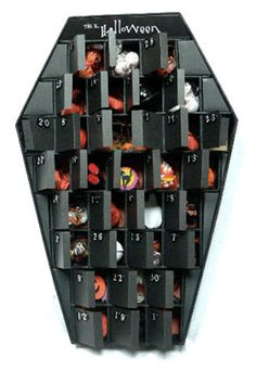 """by Gillian Holmes – an advent calendar that reveals """"candies, toys, jewelry, ornaments, stickers, and handcrafted Halloween items."""