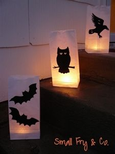 Simple and spooky Halloween Paper Bag Luminaries. Light your walkway or driveway for a spooky guide for your tick-or-treaters.      Materials Needed  	  	    Tools Needed    White Paper Lunch Bags  	  	    Scissors or Exacto Knife    725 Heavy Duty Wonder Under®  	  	    Tea light or Battery Powered light    Black Fabric  	  	    Iron    Pattern of your choosing  	  	  Sand (optional)