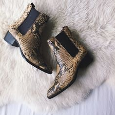 Saint Laurent Blake Python Print Booties •Saint Laurent's leather 'Blake' boots are printed and embossed to resemble python. The stacked 40mm heel is a comfortable height for all-day wear, while the slim silhouette keeps them smart enough for evening. Elasticated side panels allow this Italian-made pair to be slipped on easily, too.  •Size EU36/US6, true to size.  •New without tags or original box.  •NO TRADES/PAYPAL/MERC/HOLDS/NONSENSE. Saint Laurent Shoes Ankle Boots & Booties