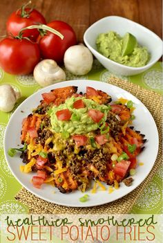 Healthier Smothered Sweet Potato Fries are a healthier, homemade version of restaurant nachos. Plus a trick to make ground beef healthier, and last longer!  iowagirleats.com