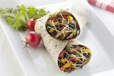 Full of fresh vegetables, these delicious wrap sandwiches are made extra special with the duo of shredded Parmesan cheese and Parmesan Caesar dressing.