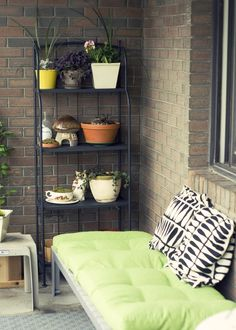 So cozy! Love the idea of a shelving unit, but with the windows, it would be tricky to find a good spot.
