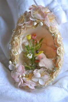 This is a beautiful vintage egg in very good condition.    I can find no problems with this.    Hand crafted from styrofoam and embellished with opalescent sequins, ivory beads and silk flowers. The inside of the egg is satin lined and has plastic flowers, a chenille chick with a mercury bead hat and some plastic easter grass.    Measures a little over 4 tall.    There is no string for hanging.      &&&&&&&&&&&&&&&&&&&amp...