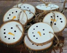 Set of Rustic Log Slice Santa Ornaments  Available in sets of 3, 5, 10, 15    *Twine not included*  Santa Hand Painted on one side. Can also be used for gift Tags!  Fresh Cut and Left Natural. This set is unsealed and Lightly Sanded. Logs/Branches are fresh cut by hand and may experience some cracking and/or bark peel (which in my opinion adds to the rustic charm) *bark and wood color varies*  Eco Friendly! With no Dyes, Stains, or Chemicals.  Bare wood is lightly sanded to open the pores…