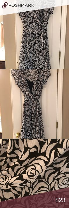 Women's black and white dress size 16 Black and White floral dress. Sheer material with a black slip. Elegant ruffled v-neck collar. Has a couple buttons down the front and has a hidden zipper down the side. Flattering waistline with long belt. Perfect dress for spring/summer or pack for a getaway vacation! MSK Dresses Midi