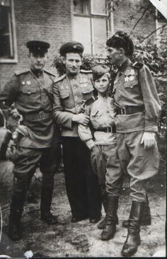 Red Army young officers and 12-year old corporal celebrate end of hostilities, May 1945.