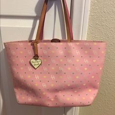 Dooney and Bourke handbag PLEASE READ: Dooney bag in pink! It has 2 SMALL ScRATCHES from placing it in the floor in the corners of the bag as pictured one in the left and other in right and is a bit dirty on the bottom and inside as the picture shows. However, the rest is in good condition. If you would like to see more pics or close ups of the dirty areas or particular part of the bag please let me know. Dooney & Bourke Bags