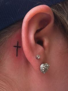 simple cross tattoo WANT!!!! i have those earrings lol but i want the tat a little bolder and bigger