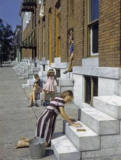 Photographic Print: Little Girl Washes Marble Steps of a Row House in Baltimore by W. Robert Moore : 16x12in