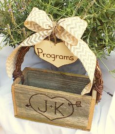 Programs box. The people who want will one will take it home, but it's good to have something in the back of church for people to put the extras in. You can simply take it to the reception and then people who couldn't make it to the wedding can still have a chance to see it.