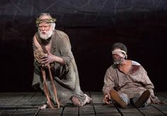 "John Lithgow (Lear), far left, with Clarke Peters (Gloucester) in the Shakespeare in the Park production of ""King Lear"" at the Delacorte Theater."