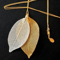 Mixed metals give this look dimension and shine. Wear with a v-neck sweater for stunning effect.