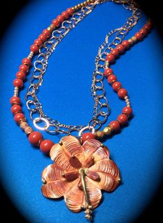 "Power to the Flower by Finales on Etsy A copper Hibiscus flower ""grows"" from three strands of coral pearls and copper chains! Wear as casual as a beach dress or as formal as a cocktail dress!! Your choice!!"