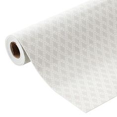 Our luxurious Fabric-Top Drawer Liner is thicker than most liners for added softness and cushion. It's ideal for use in a closet, bath or linen closet. The non-adhesive liner can be cut to size with scissors; unroll it and it lays flat in a drawer or on a shelf. The backing grips the surface of the drawer or shelf to prevent sliding.