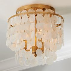 Check out Elegant Capiz Shell Ceiling Light from Shades of Light White iridescent capiz shell discs hang in multiple tiers from this elegant and classic sconce frame. Available in Antique Silver or our exclusive Antique Gold. Ceiling Light Shades, Ceiling Light Design, Semi Flush Ceiling Lights, Modern Ceiling, Flush Mount Lighting, Lighting Design, Lighting Shades, Bathroom Ceiling Light, Ceiling Light Fixtures