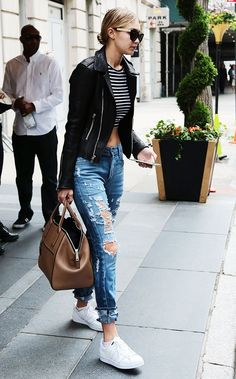 distressed denim, white trainers, stripped crop top, black leather jacket and holdall. Cool, edgy street style from Gigi Hadid @WhoWhatWearUK #Mylifemystyle