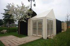 Wooden house auction: Estonian pavilion at Floriade Wooden House, Pavilion, Garage Doors, Auction, Houses, Outdoor Decor, Home Decor, Homes, Decoration Home