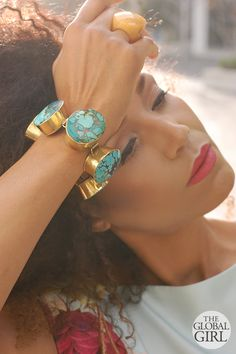 Ndoema wears a custom turquoise and brass oversized bracelet with yellow agate ring.