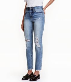 Denim blue. 5-pocket, ankle-length jeans in washed denim with heavily distressed details and a loose fit. High waist, dropped gusset, button fly, and
