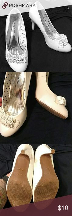 """Torta Caliente White Patent Ruffle Heels White patent heel in good used condition. Priced to sell. Worn once and felt too small. I'm a true ten and these are a little tight, probably fit a 9.5 better. There are a few small scuffs that could probably be removed with alcohol. These are super cute with a 3 1/2"""" heel. Torta Caliente  Shoes Heels"""