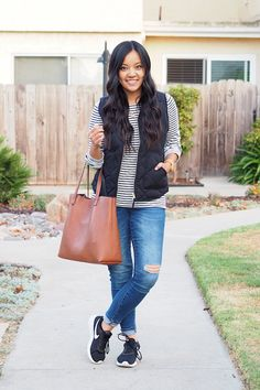 Casual Fall Outfit: black vest + striped tee + black sneakers