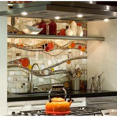 Unique orange-red mosaic backsplash could turn up your mood in the kitchen. #rumahkukitchen