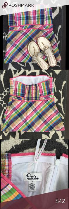 Lilly Pulitzer Sz 4 Whitworth Plaid Strapless Top This size 4 Lilly Pulitzer Whitworth Strapless Top Summer in Plaid Meridan Madras is perfect for those hot summer nights!  It will go great with some summer white shorts or skinny jeans.  The bust has boning to help with shape and support.   It has stretchy elastic smockingin the back for a perfect fit. Cotton poplin. Fully lined. Hidden zipper. Excellent used condition.  Also  available in a size 6, so please look at my other listings…