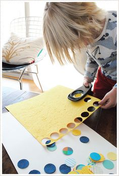 circle punch art... looks super cool and super easy for the kids to do.  Great way to use that random scrapbooking paper I have.