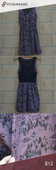 Tribal Print Lace Dress This is a super cute super comfy purple tribal print dress with black lace on the back. It has an elastic band at the waist to give a nice sinched in look and has a cute zipper on the front! It has one little snag you can see but it's not major. Can easily be layered with a cute sweater, tights, and a scarf for the perfect fall outfit! Forever 21 Dresses