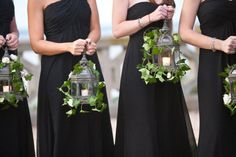 bridesmaids carrying lanterns instead of bouquets