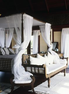 Tropical romantic airy bedroom. Love the bench. source Lonny