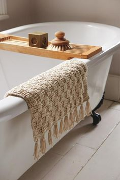 Long surface stitches add depth to this soft cotton mat and give it a strongly woven appearance.