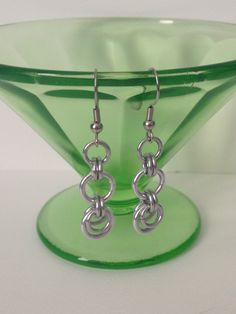 A personal favorite from my Etsy shop https://www.etsy.com/listing/108544178/aluminum-chainmaille-crescent-earrings
