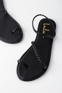 The Mirela Black Flat Sandals are more than worthy of admiration! Braided vegan leather forms a toe loop, plus two more straps that cross the vamp and ankle.