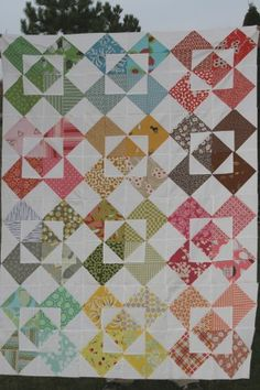 Colorful triangle quilt from Film in the Fridge