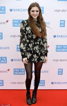 Floral look: Singer Birdy wowed in a chintz-patterned black and green frock...