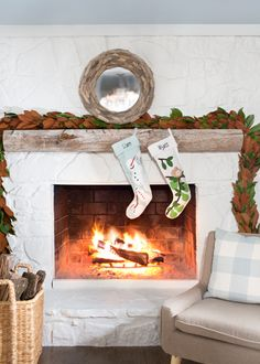 Julie and Chris updated the stone fireplace with white paint and a reclaimed beam-turned-mantel.