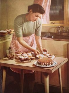 In the kitchen, Good Housekeeping, 1953.  I have this exact cookbook. It's weird seeing a picture from it on pinterest.... kind of anachronistic.