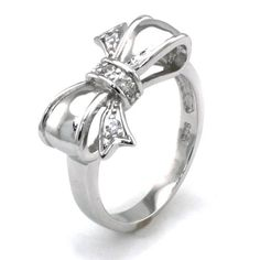 $25.00 This adorable infinity bow ring is crafted in the finest 925 sterling silver material and embedded with cubic zirconia stones. It is the perfect wear for every occasion and will have others feeling envy. Bow dimension: 19mm x 11mm