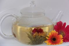 Blooming tea with a beautiful 24 oz Glass tea pot. Makes a great gift for that special woman in your life.   Starting at $32.99