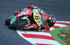 Stefan Bradl - dragging elbow... This is an amazing picture, and it depicts just how far race bikes have come in 20 years. Tire technology and suspension technology have improved tremendously.