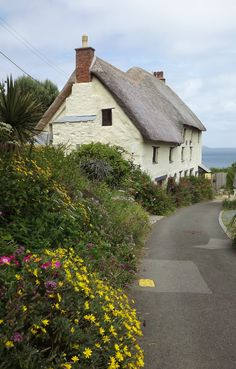 A thatched cottage at one of the two Church Cove's near Lizard in Cornwall, England