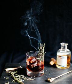 Our second Halloween cocktail is inspired by nightly rides through the dark  forest, where the Headless Horseman gallops back and forth to the scene of  battle in a quest for his head. A smoky mezcal is blended with allspice  dram to bring together fall's autumnal flavors. To finish the drink, try  lighting up a sprig of rosemary and awaken the spirits of the night.  Photography & Styling: Diana Yen  Styling & Recipe Assistants: Lina Kroencke & Piper Skillman