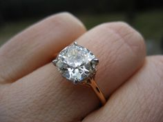 yes, not crazy about yellow gold, but this is stunning. Antique Cushion Cut Diamond Ring best mix of bezel and solitaire?