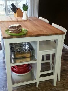IKEA's Butcher block table with stainless steel shelves. I think I could use this idea for my kitchen/dining