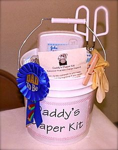 SO CUTE Daddy-to-be diaper kit.    I couldn't find this on the link that is attached so here's one that works:  http://sawyers-specialties.com/survival-kits/parents/dads-diapering.php