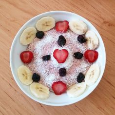 Strawberry-eggwhite oatmeal with chia seeds,banana,coconut,black cherry and strawberry